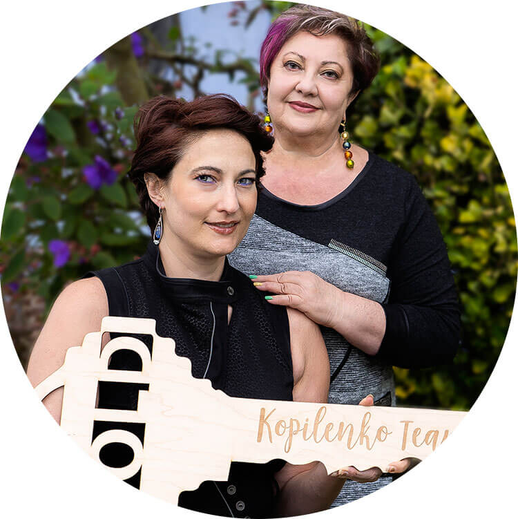 Beatrice and Vera Kopilenko San Francisco Real Estate Agents holding a sold sign in the shape of a key